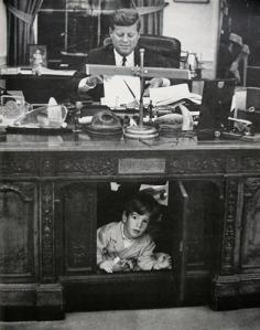 JFK_jr_under_presidents_desk_m